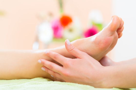 woman-in-nail-salon-receiving-foot-massage