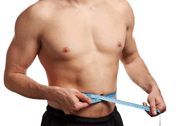 male-torso-with-measure-tape-on-waistline