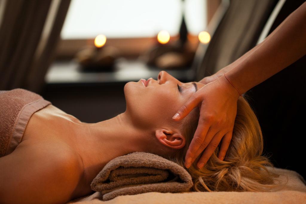 beautiful-young-woman-enjoys-massage