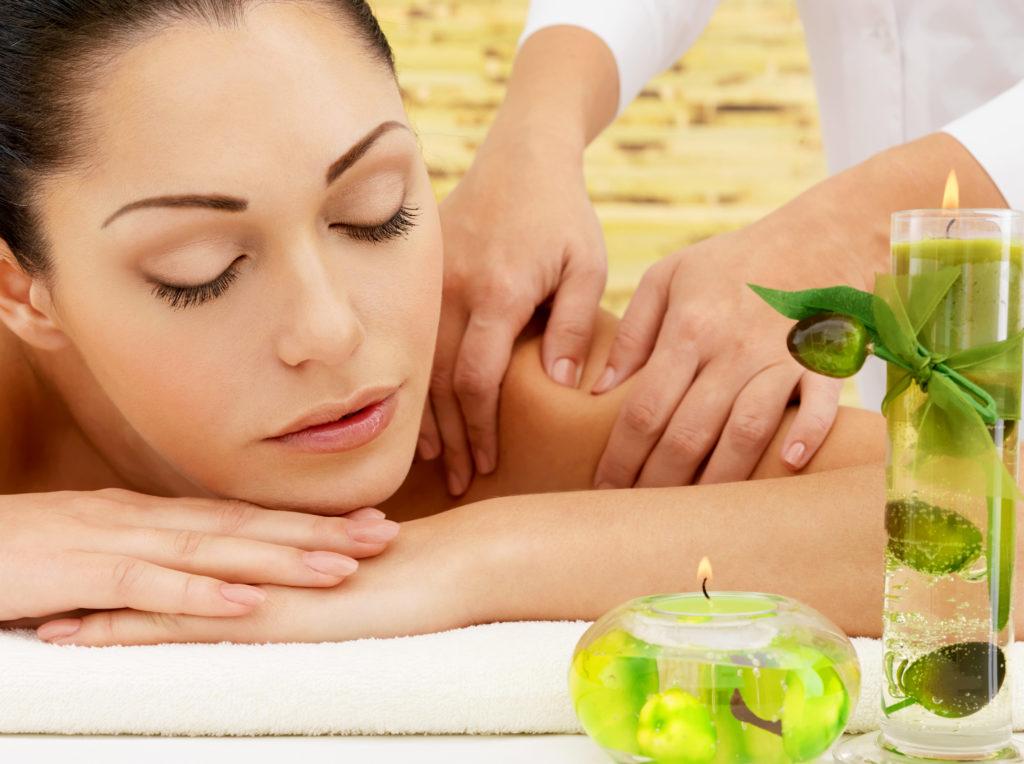 woman-having-massage-of-body-in-spa-salon
